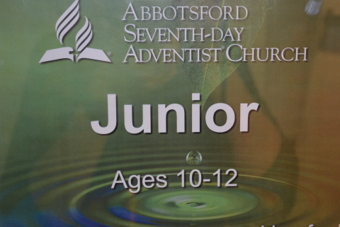 "graphic saying ""Junior"" ages 10-12"