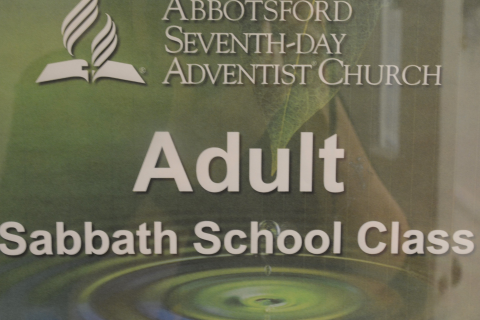 "Graphic sign saying, ""Adult Sabbath School Class"""